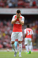 Laurent Koscielny of Arsenal shows his frustration.  Barclays Premier League, Arsenal v West Ham Utd at the Emirates Stadium in London on Sunday 9th August 2015.<br /> pic by John Patrick Fletcher, Andrew Orchard sports photography.