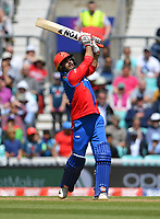 Cricket - 2019 ICC Cricket World Cup warm-ups - England vs. Afghanistan <br /> <br /> Afghanistan's Mohammad Nabi hits a six off the bowling of England's Moeen Ali, at The Oval.<br /> <br /> COLORSPORT/ASHLEY WESTERN