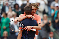 Dominic Thiem (AUT) arms in arms at the end of the game with Alexander Zverev (GER) during the Roland Garros French Tennis Open 2018, day 10, on June 5, 2018, at the Roland Garros Stadium in Paris, France - Photo Stephane Allaman / ProSportsImages / DPPI