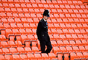 Policeman walks past empty seating after the crowd tragedy at Anfield Stadium, The Kop, Liverpool Football Club ground, UK