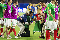 July 20, 2017 - Glendale, Arizona, U.S - A Mexico fan is grab by security after running onto the field   after the game against Honduras Thursday, July 20, 2017, during the 2017 Gold Cup Quarterfinals at University of Phoenix Stadium in Glendale, Arizona.  Mexico won 1-0 against Honduras to advance to the 2017 Gold Cup Semifinals. (Credit Image: © Jeff Brown via ZUMA Wire)