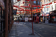Lanterns hanging from above in Chinatown, Soho which is almost deserted due to the Covid-19 outbreak social distancing on what would normally be a busy, bustling day with hoards of people out to shop and socialise on 22nd March 2020 in London, England, United Kingdom. Coronavirus or Covid-19 is a new respiratory illness that has not previously been seen in humans. While much or Europe has been placed into lockdown, the UK government has announced more stringent rules as part of their long term strategy, and in particular social distancing.