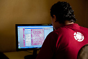 A designer working on his computer. Amity Factory does not employ children and is a licensee of the GoodWeave Foundation and their carpets carry the GWF label.The weavers work according to the design,printed on paper hanging above them. Most are women and many mothers and they work inthe factory 12-14 hours /day 6 days/week.  The Good Weave Foundation is a charity set up in partnership with the Nepalese carpet industry. The aim is to eliminate child labor in all carpet factories in Nepal. Factories which do not employ children can sign up with the charity and become a licensee to the GWF brand and label their carpets with the GWF label which promises any buyers abroad that no children were involved in making the carpets.