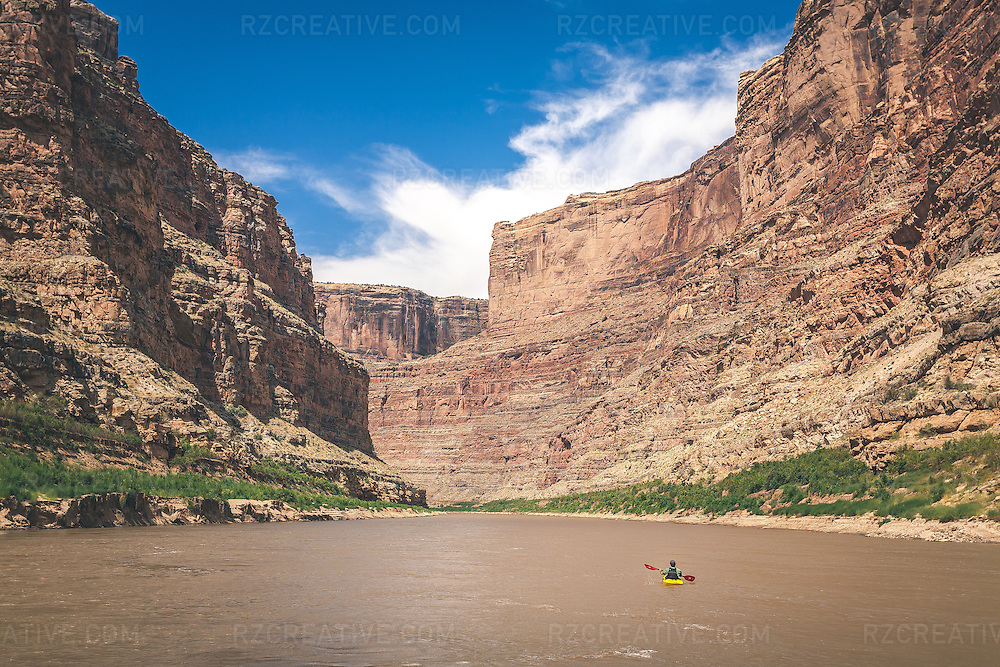 This image was captured during a week-long river trip through Cataract Canyon on the Colorado River in Utah. This whitewater kayaker, part of our group, had paddled ahead of the rest of the pack when I made this capture.