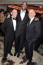 Left to right, FRANKIE DETTORI, ED MOSES and BARRY McGUIGAN at the 21st Cartier Racing Awards held at The Dorchester, Park Lane, London on 15th November 2011.