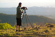 A photographer takes a break from photographing the vista on Boulder Mountain.