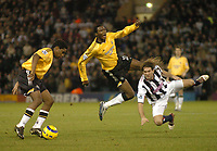 Fotball<br /> Premier League England 2004/2005<br /> Foto: SBI/Digitalsport<br /> NORWAY ONLY<br /> <br /> West Bromwich Albion v Newcastle United<br /> <br /> Newcastle's Charles N'Zogbia (L) maintains possession for his team after Shola Ameobi (C) was sent airborne from a hard tackle by Andy Johnson (R).