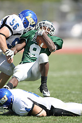 15 September 2007:  Marcus Dunlop falls backwards over Joel Steinmetz and Rocky Siegel finishes off the tackle. The Titans stood toe to toe with the 25th ranked Lions through the first half but ended the game on the losing end of a 25-15 score at Wilder Field on the campus of Illinois Wesleyan University in Bloomington Illinois.