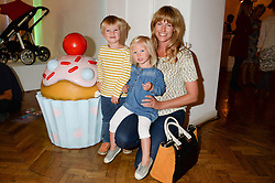 MARINA FOGLE and her children LUDO FOGLE and IONA FOGLE at a children's tea party to celebrate the 80th anniversary of iCandy - the luxury British pushchair brand held at One Marylebone, Marylebone Road, London NW1 on 10th September 2013.