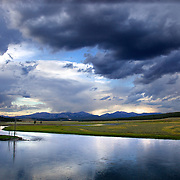 The Yellowstone River winds through beautiful Hayden Valley meadows in Yellowstone National Park.