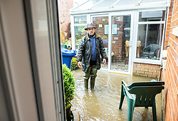 © Licensed to London News Pictures. 06/10/2020. Bury, UK. PETER CRABTREE (76) in his flooded home . Houses and roads flood on Tottington Road in Bury after drainage systems are overwhelmed by the volume of water and blockages in the wake of persistent, heavy rain . Photo credit: Joel Goodman/LNP