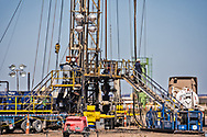 March 5, Permain Basin in Texas- workers at a site that is being drilled before a frac job.