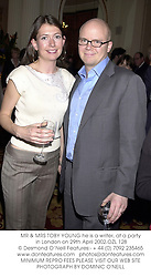 MR & MRS TOBY YOUNG he is a writer, at a party in London on 29th April 2002.<br />OZL 128