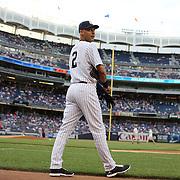 Derek Jeter, New York Yankees, heads onto the field before the New York Yankees Vs Cincinnati Reds baseball game at Yankee Stadium, The Bronx, New York. 18th July 2014. Photo Tim Clayton