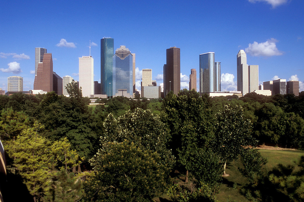 Houston, Texas skyline with trees viewed from the western side.