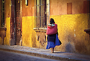 A native woman walks through the streets of San Miguel de Allende in Central Mexico.