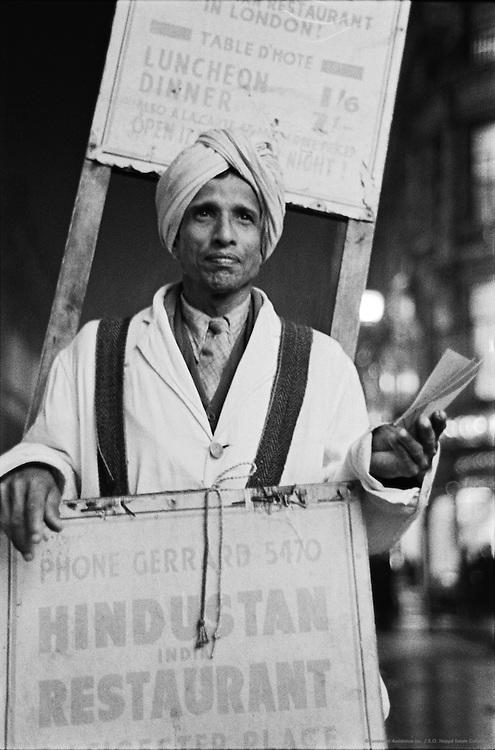 Indian with Sandwich-Board Advertising Hindustani Restaurant, London, 1945