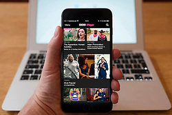 Using iPhone smartphone to display homepage of BBC iPlayer TV streaming service