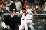 Cleveland Indians' Mike Aviles is doused with water by teammates after hitting a game-winning solo home run off Baltimore Orioles relief pitcher Brian Matusz in the eleventh inning of a game, Friday, August 15, 2014, in Cleveland. The Indians defeated the Orioles 2-1.