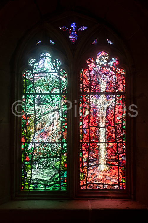 Interior stained glass view in the Audley Chapel of Hereford Cathedral on 7th June 2021 in Hereford, United Kingdom. Hereford Cathedral is the cathedral church of the Anglican Diocese of Hereford, England. A place of worship has existed on the site of the present building since the 8th century or earlier. The present building was begun in 1079. Substantial parts of the building date from both the Norman and the Gothic periods.
