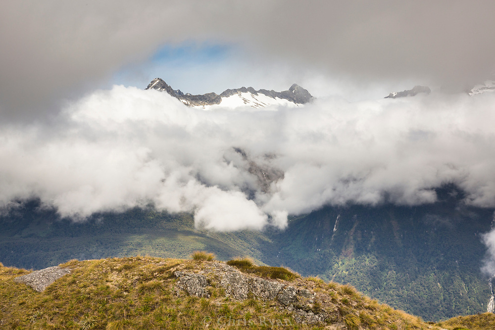 Mountain peaks appearing through a break in the clouds, Routeburn Track, South Island, New Zealand