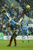 Photo: Aidan Ellis.<br /> Wigan Athletic v West Bromwich Albion. The Barclays Premiership. 15/01/2006.<br /> Wigan's Arjun De Zeuw  misses a chance with this header as West Brom's Kevin Campbell looks on