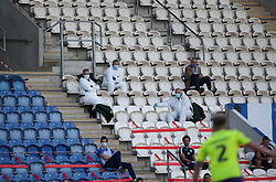 Men in white suits can be seen in the stand - Mandatory by-line: Arron Gent/JMP - 18/06/2020 - FOOTBALL - JobServe Community Stadium - Colchester, England - Colchester United v Exeter City - Sky Bet League Two Play-off 1st Leg