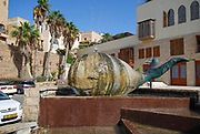 Renovated old town of Jaffa, Israel now an artist colony and tourist attraction. Statue of a whale