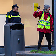 NLD/Amsterdam/20200218 -  Koningspaar bij seminar 'indonesia and the Netherlands, politie stuurt protesterende man weg