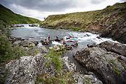 Lining raft through the lower falls on the Kisaralik River, Alaska