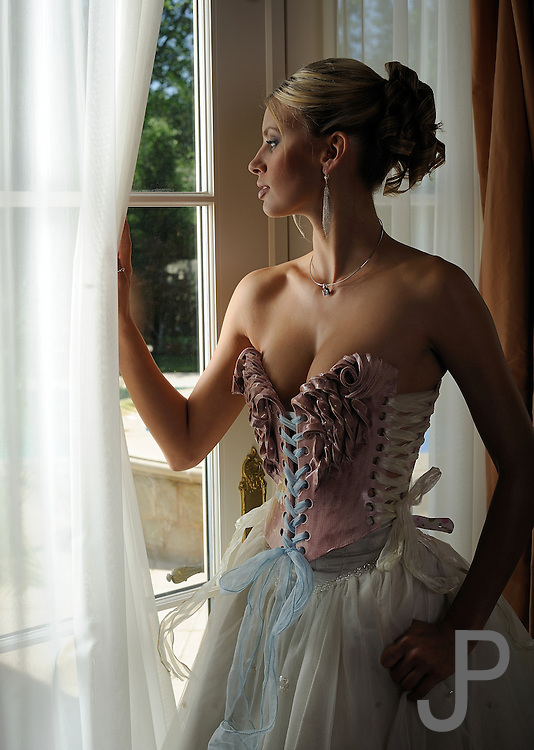 Emily Cochran in ceramic corset by Nicole Moan.  Hair by Tom Sollock, casting by Denna Armstrong