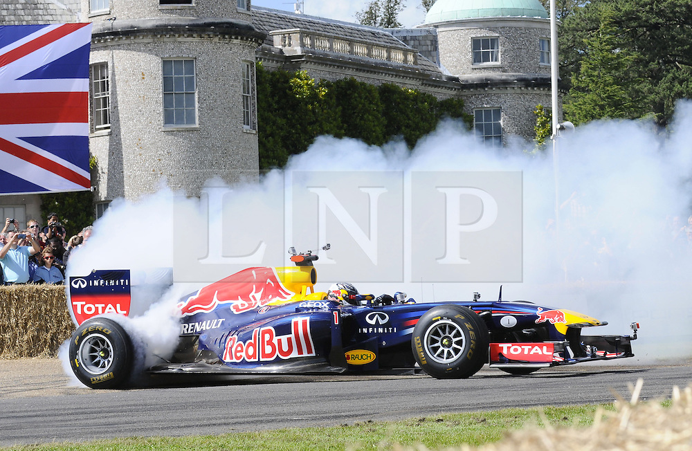 © Licensed to London News Pictures. 30/06/2012 .Sebastian Vettel wheelspining at Goodwood.The Goodwood Festival of Speed is the largest motoring garden party in the world - a unique summer weekend, The largest car culture event in the world. Held in the grounds of Goodwood House, Chichester..Photo credit : Grant Falvey/LNP