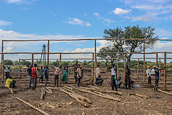 The building of a new reception centre at BidiBidi in underway. Only three days old, the area will be able to register and accomodate more refugees as they keep arriving. More than 300,000 South Sudanese refugees have fled from the country's civil war into Uganda since fighting broke out in July. They mostly travel by foot for days through the bush as roads have been blocked or are too dangerous to cross. The massive influx of refugees has caused a strain in humanitarian aid due to large numbers and lack of funding. BidiBidi settlement is now the third largest in the world and holds more than 210,000 people since its opening in September.