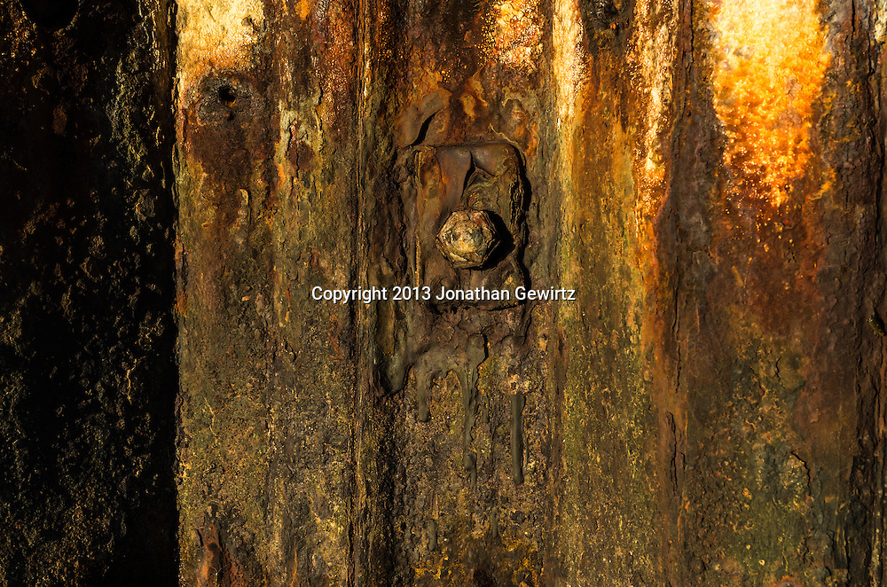 Detail of a rusty metal seawall. WATERMARKS WILL NOT APPEAR ON PRINTS OR LICENSED IMAGES.