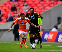 Blackpool's Demi Mitchell under pressure from Lincoln City's Tayo Edun<br /> <br /> Photographer Andrew Vaughan/CameraSport<br /> <br /> The EFL Sky Bet League One Play-Off Final - Blackpool v Lincoln City - Sunday 30th May 2021 - Wembley Stadium - London<br /> <br /> World Copyright © 2021 CameraSport. All rights reserved. 43 Linden Ave. Countesthorpe. Leicester. England. LE8 5PG - Tel: +44 (0) 116 277 4147 - admin@camerasport.com - www.camerasport.com