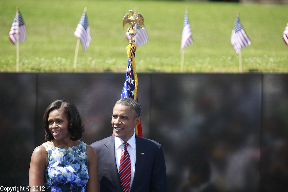 President Barack Obama and First Lady Michelle Obama greet an audience of Vietnam Veterans and their families after the United States of America Vietnam War Commemoration National Announcement and Proclamation Ceremony at the Vietnam Veterans Memorial Wall.