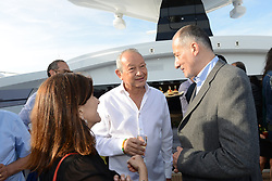 L-R : Egyptian billionaire Naguib Sawiris (center) talks with guests on his private yacht in Cannes, France on May 21, 2017. Sawiris organized a party on his yacht to announce the launch of a new film festival to take place in Egypt in September 2017 at El Gouna small town. Photo by Ammar Abd Rabbo/ABACAPRESS.COM