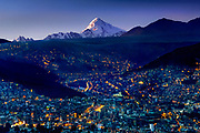 Huyana Postosi Mountain rises over the city of La Paz, Bolivia.