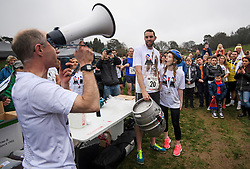 © Licensed to London News Pictures. 08/04/2018. Dorking, UK. Winners of the race CHRIS HEPWOTH AND TANISHA PRINCE (right) are presented with a barrel of beer. Competitors take part in the 2018 annual Wife Carrying Race in Dorking, Surrey. The race, which is run over a course of 380m, with both men and women carry a 'wife' over obstacles, is believed to have originated in the UK over twelve centuries ago when Viking raiders rampaged into the northeast coast of England carrying off any unwilling local women . Photo credit: Ben Cawthra/LNP