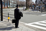 businessman standing at a zebra crossing