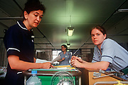 A senior nursing Sister and a junior nurse work in a 1990s ward at the Royal London, Whitechapel, on 23rd June 2018, in east London, England.