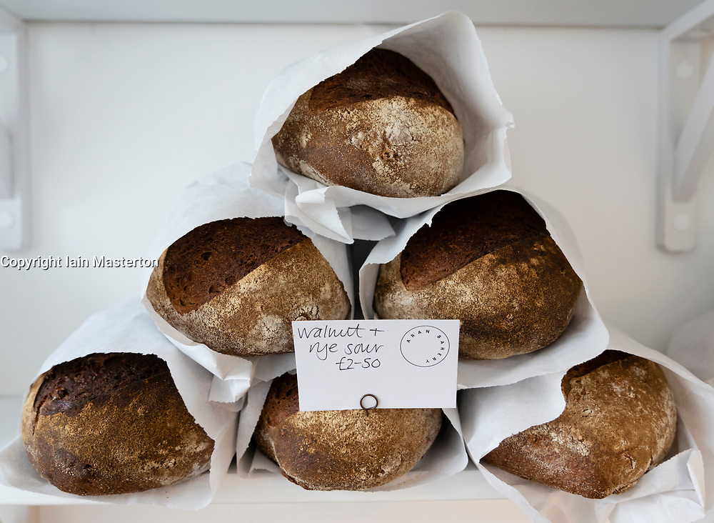 Detail of artisan loaves of bread on a shop shelf