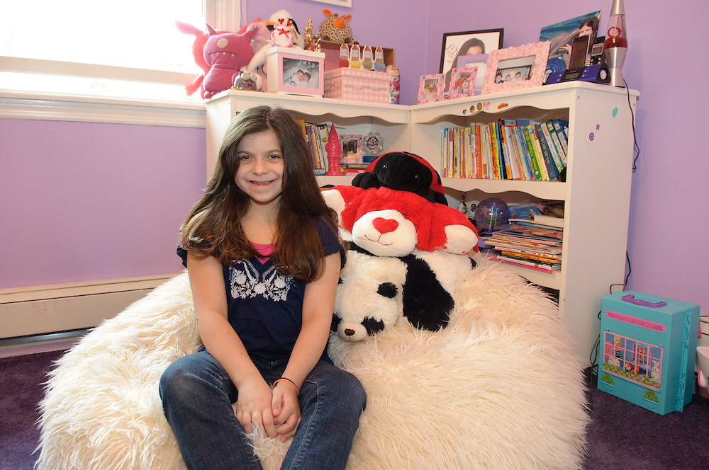 Mt. Kisco, NY:  Brooke Dodderidge in her bedroom in Mount Kisco, NY. Brooke was born on September 11th, 2001, the day the US was undertack and terriorist attacks took down the World Trade Towers. Her parents strive on making sure Brooke knows that her birthday is a special day because it is her birthday, not because of the terror attacks.     Photos by Tiffany L. Clark