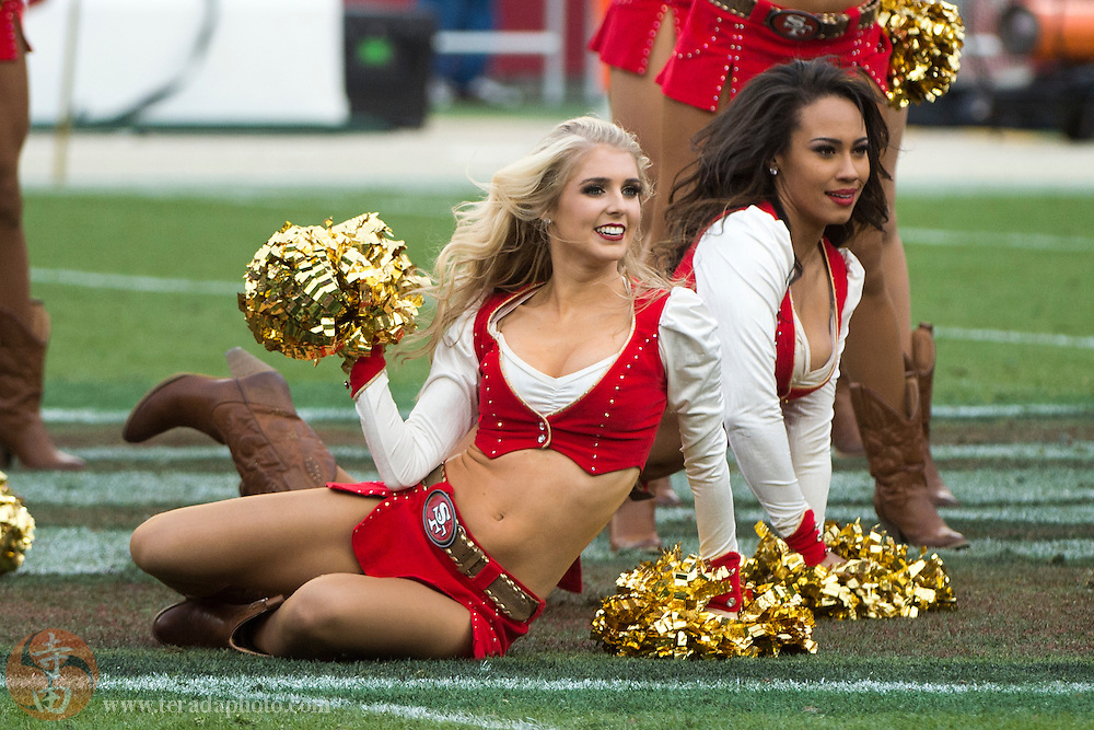 January 3, 2016; Santa Clara, CA, USA; San Francisco 49ers Gold Rush cheerleaders Allison (front) and Kayla (back) perform during halftime against the St. Louis Rams at Levi's Stadium. The 49ers defeated the Rams 19-16.