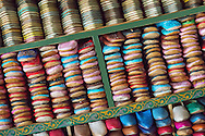 Colourful moroccan babouches, folded on a shelf, in the tanneries of Fès, Morocco.