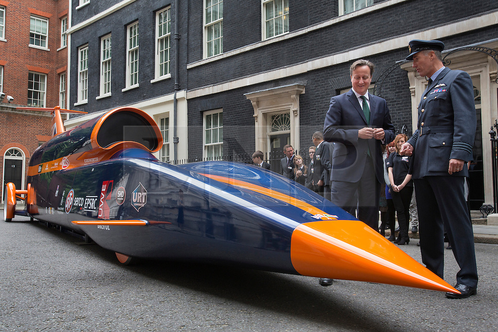 © licensed to London News Pictures. London, UK 24/06/2013. Prime Minister David Cameron talking to Captain Andy Green next to a replica of 13-metre long jet-and-rocket propelled Super Sonic Car on Downing Street, the car aims to beat the current land speed record of 763mph in 2014 and also to be the first land vehicle to exceed 1,000mph by 2015. Prime Minister is to announce a new apprenticeship initiative to create 100,000 Engineering Technicians. Photo credit: Tolga Akmen/LNP