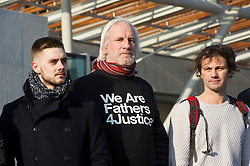 Pictured: David Albury was flanked by younger members of Fathers for Justice.<br /> Members of Father's For Justice gathered outside the Scottish Parliament todayto highlight increased suicide risk. A new campaign, Forgotten Fathers, has been set up to encourage fathers to talk more about their love for their children after research found 23% of Scots believe that mothers love their children more than fathers.<br /> <br /> <br /> <br /> Ger Harley | EEm 14 February 2017