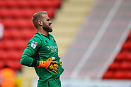 Shrewsbury Town goalkeeper Joel Coleman (1) is winded after a collision during the EFL Sky Bet League 1 match between Charlton Athletic and Shrewsbury Town at The Valley, London, England on 11 August 2018.