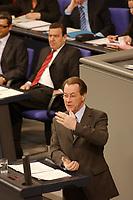 19 MAR 2003, BERLIN/GERMANY:<br /> Franz Muentefering (vorne), SPD Fraktionsvorsitzender, und Gerhard Schroeder (hinten), SPD, Bundeskanzler, waehrend seiner Rede  von Muentefering, Bundestagsdebatte, Generalaussprache, Haushaltsdebatte, Einzelplan Bundeskanzleramt, Plenum, Deutscher Bundestag<br /> IMAGE: 20030319-01-010<br /> KEYWORDS: Debatte, Gerhard Schröder, speech, Franz Müntefering