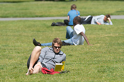 ©Licensed to London News Pictures 12/05/2020<br /> Greenwich, UK. A man reading a book while sunbathing. People come out of Coronavirus lockdown to enjoy the warm weather by relaxing in Greenwich park, Greenwich, London this afternoon. Photo credit: Grant Falvey/LNP